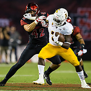15 September 2018: San Diego State Aztecs linebacker Troy Cassidy (42) tackles Arizona State Sun Devils running back Eno Benjamin (3) in the third quarter. The Aztecs beat the Sun Devils 28-21 at SDCCU Stadium in San Diego, California.