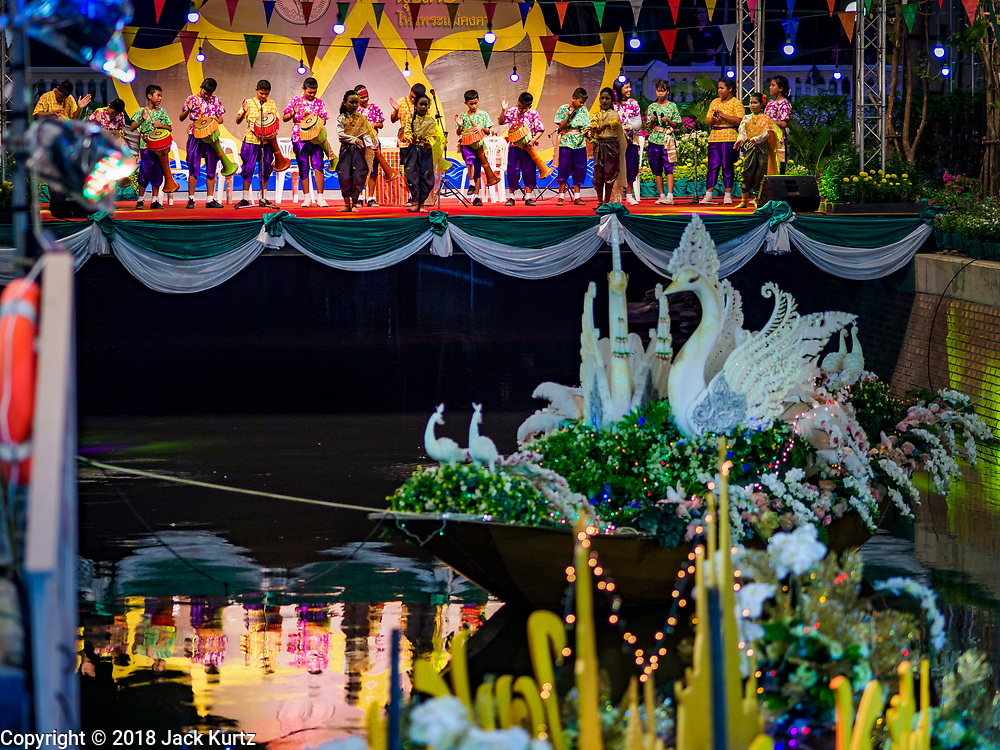 19 NOVEMBER 2018 - BANGKOK, THAILAND: during the Loy Krathong Fair along Klong (Canal) Ong Ang in Bangkok. This the first public event along the canal. Businesses that line the canal weve evicted about two years and the walkways along the canal were renovated. Loy Krathong takes place on the evening of the full moon of the 12th month in the traditional Thai lunar calendar. In the western calendar this usually falls in November. Loy means 'to float', while krathong refers to the usually lotus-shaped container which floats on the water. Traditional krathongs are made of the layers of the trunk of a banana tree or a spider lily plant. Now, many people use krathongs of baked bread which disintegrate in the water and feed the fish. A krathong is decorated with elaborately folded banana leaves, incense sticks, and a candle. A small coin is sometimes included as an offering to the river spirits. On the night of the full moon, Thais launch their krathong on a river, canal or a pond, making a wish as they do so.  Loy Krathong will be celebrated on November 22 this year.     PHOTO BY JACK KURTZ