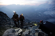 """Alpinists at dawn on the Hornli ridge.<br /> <br /> """"Matterhorn 150 years Cervino"""" - The year 2015 is the 150th Anniversary of the first ascent by Edward Whymper from the Swiss side (14th July) and by Jean Antoine Carrel from the Italian side on the 17th July 1865.<br /> On 17th July 2015 a friendship convention was signed by the members of Swiss, French, British and Italian climbing teams. A ceremony was held at the summit in honour of the mountain."""