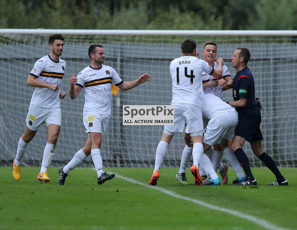players mob Brophy after scoring  during the Dumbarton FC  v Livingston FC Scottish Championship 3rd October 2015 <br /> <br /> (c) Andy Scott | SportPix.org.uk