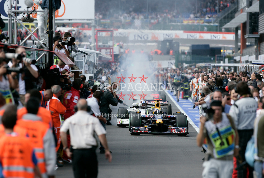 SPA FRANCORCHAMPS, BELGIUM - Sunday, August 30, 2009: The car of Rubens Barrichello (BRA, Brawn GP) catches fire in the pit lane behind Mark Webber during the Belgian Grand Prix at the  Circuit of Spa Francorchamps. (Photo by Juergen Tap/Hochzwei/Propaganda)