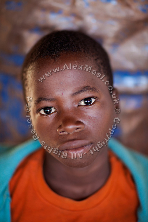 A young worker is standing in the artisanal gold processing site of the village of Bagega, pop. 9000, Zamfara State, Nigeria. The lead contamination in the area is caused by ingestion and breathing of particles released in the steps to isolate the gold from other metals. This type of lead is soluble in stomach acid and children under-5 are most affected, as they tend to ingest more through their hands by touching the ground, and are developing symptoms often leading to death or serious disabilities.