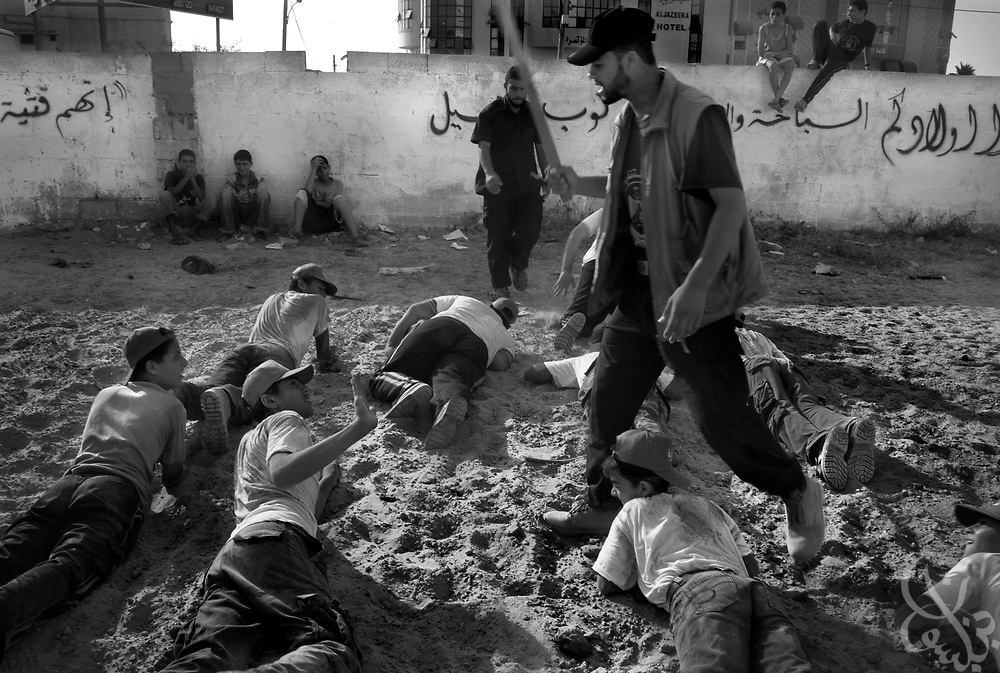 A HAMAS camp trainer threatens to beat a young Palestinian boy for making a mistake during training August 01, 2007 at a HAMAS sponsored summer camp in Gaza City, Gaza. Kids at the camp are given military style training  meant to toughen them up, and often endure whippings, smacks of a stick and sand kicked in their eyes by their HAMAS trainers.