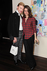 HENRY CONWAY and BENEDETTA GHIONE at a private view of Atelier-Mayer.com's collection held at 131 Oakwood Court, London, on 24th November 2009.