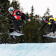 Snowboard-Cross racers Mike Robertson (6 - CAN) and Michal Novotny (11 - CZE) battle during semi-final race action at the 2009 LG Snowboard FIS World Cup on February 13th, 2009 at Cypress Mountain, British Columbia. Mandatory Photo Credit: Bella Faccie Sports Media\Thomas Di Nardo. Contact: Thomas Di Nardo, Snohomish, Washington, USA. Telephone 425-260-8467. e-mail: tom@bellafaccie.com