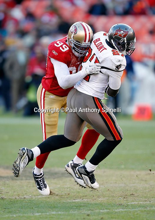 Tampa Bay Buccaneers running back LeGarrette Blount (27) gets chased and tackled on a busted running play by San Francisco 49ers linebacker Manny Lawson (99) during the NFL week 11 football game against the San Francisco 49ers on Sunday, November 21, 2010 in San Francisco, California. The Bucs won the game 21-0. (©Paul Anthony Spinelli)
