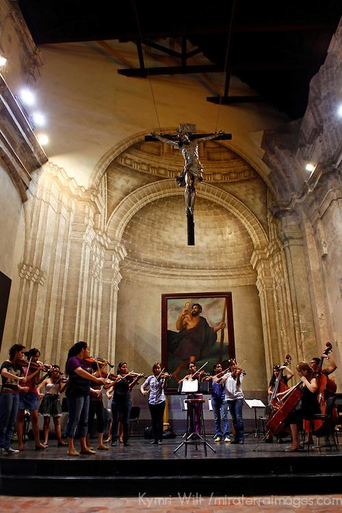 """Central America, Cuba, Havana. Cuban Orchestra """"Camerata Romeu"""" rehearses in Basilica Menor de San Francisco de Asis."""