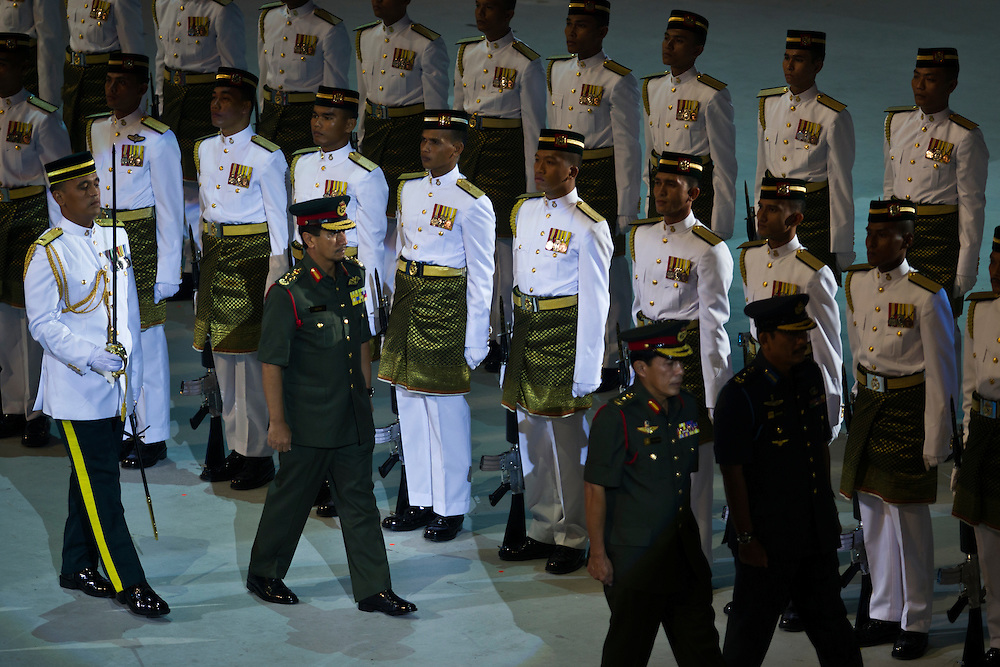 Malaysian King Sultan Mizan inspects guard of honor during the Independence Day celebration.