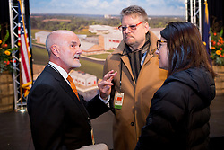 Founder Tom Bulleit talks with bottle designer Steve Sandstrom creative director of Sandstorm Partners in Portland, Oregon, before the Bulleit Distilling Co., ribbon cutting with parent company Diageo, Tuesday, March 14, 2017 at Bulleit Distilling Company in Shelbyville.