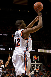 Virginia's Jamil Tucker (12) shoots one of his three 3 pointers against Maryland.  The Cavaliers defeated the #22 ranked Terrapins 103-91 at the John Paul Jones Arena in Charlottesville, VA on January 16, 2007.