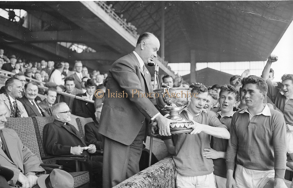 GAA All Ireland Minor Football Final Kerry v Mayo 23rd September 1962 Croke park..President of GAA Aodh O'Broin presents minor cup to Kerry Captain S.O'Mahoney ..23.9.1962  23rd September 1962..All Ireland SFC - Final.Kerry 1-12 | Roscommon 1-6.Time: Unknown, Venue: Croke Park.Referee: E. Moules (Wicklow).Captain: S.g Sheehy..Attendance: 75,771