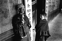 CATARACT BLINDNESS IN TIBET. A TIBETAN MONK BLINDED BY CATARACT WAITS TO HAVE HIS EYES EXAMINED.