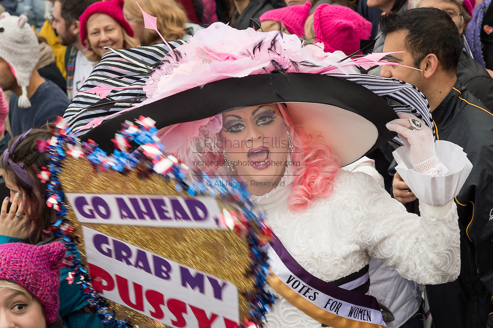 A transexual woman shouts slogans during the Women's March on Washington in protest to President Donald Trump January 21, 2017 in Washington, DC. More than 500,000 people crammed the National Mall in a peaceful and festival rally in a rebuke of the new president.