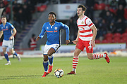 Kgosi Nthle starts an attack during the The FA Cup 3rd round match between Doncaster Rovers and Rochdale at the Keepmoat Stadium, Doncaster, England on 6 January 2018. Photo by Daniel Youngs.