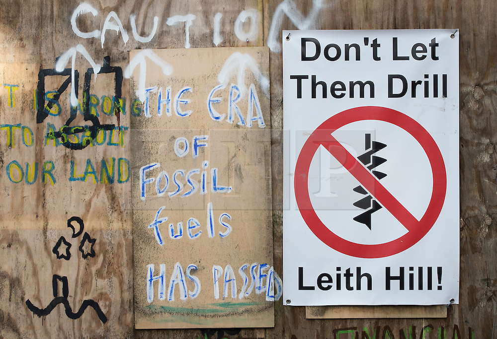 © Licensed to London News Pictures. 02/03/2017. Coldharbour, UK. Signs against drilling are displayed on the walls of the 'Protection Camp' on Leith Hill. Activists have constructed and occupied a fort and some trees on the site of a proposed oil well. Planning permission for 18 weeks of exploratory drilling was granted to Europa Oil and Gas in August 2015 after a four-year planning battle. The camp was set up by protestors in October 2016 in order to draw  attention to plans to drill in this Area of Outstanding Natural Beauty (AONB) in the Surrey Hills. The camp has received support from the local community.  Photo credit: Peter Macdiarmid/LNP