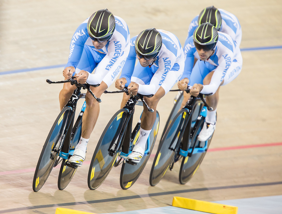 The Argentinean team of Adrian Richeze Mauro Agostini Walter Perez and Maximiliano Richeze race in the 1st round of the men's cycling team pursuit  at the 2015 Pan American Games in Toronto, Canada, July 18,  2015.  AFP PHOTO/GEOFF ROBINS