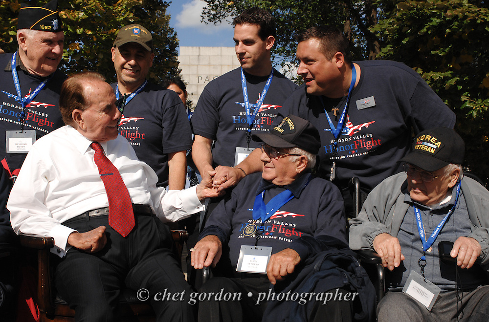 Former Senator Bob Dole (R-Kan., left) with WWII Veterans and their escorts at the WWII Memorial in Washington, DC on Saturday, October 18, 2014. Seventy-five WWII Veterans from the Westchester County area toured the WWII Memorial and Arlington National Cemetery onboard the inaugural flight from Westchester County Airport in White Plains, NY. Hudson Valley Honor Flight is a chapter of the Honor Flight Network, which provides free flights for WWII Veterans and tours of the WWII Memorial constructed in their honor, and other sites in the nation's capital.  © www.chetgordon.com