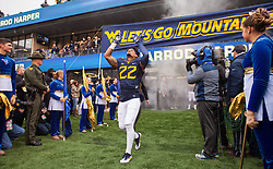 Dec 3, 2016; Morgantown, WV, USA; West Virginia Mountaineers safety Jarrod Harper (22) runs out during senior day ceremonies before their game against the Baylor Bears at Milan Puskar Stadium. Mandatory Credit: Ben Queen-USA TODAY Sports