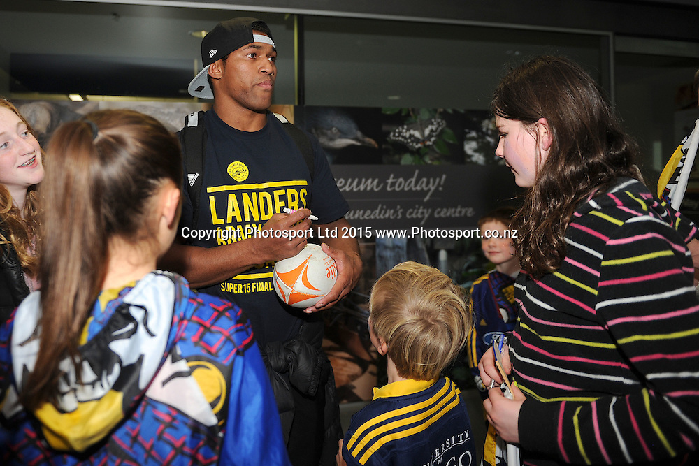 Waisake Naholo of the Highlanders signs autographs, during the Highlanders Airport Arrival after winning the Super Rugby Title, Dunedin Airport, Dunedin, New Zealand, 5 July 2015. Credit: Joe Allison / www.Photosport.co.nz