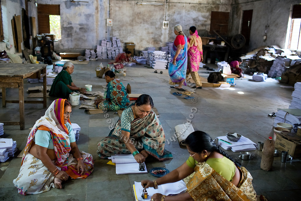 Rashida Bee, 56, (centre/front) the co-funder of Chingari Trust Rehabilitation Centre for disabled children, is working the premises of Gas Peedit Mahila Stationary Ikai, a union of 'gas-affected women', of which she is also the president, in Bhopal, Madhya Pradesh, India.