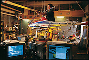 Deep in the basement of the Carnegie Mellon Robotics Institute, Omead Amidi adjusts the wing of the robot helicopter he is designing with Takeo Kanade, a Carnegie Mellon researcher who specializes in robotic vision. Several smaller versions of the project sit in his workshop. Pittsburgh, PA. From the book Robo sapiens: Evolution of a New Species, page 160-161.