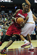 March 29, 2010; Cleveland, OH, USA; Miami Heat power forward Chris Bosh (1) drives past Cleveland Cavaliers center Ryan Hollins (5) during the fourth quarter at Quicken Loans Arena. The Cavaliers beat the Heat 102-90. Mandatory Credit: Jason Miller-US PRESSWIRE