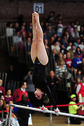 February 7, 2010; Stanford, CA, USA; Stanford Cardinal gymnast Carly Janiga performs on the bars during a quad-meet against the Washington Huskies, the Sacramento State Hornets, and the San Jose State Spartans at Burnham Pavilion. Stanford scored 196.650, Washington 194.075, Sacramento State 193.225, and San Jose State 192.800. Mandatory Credit: Kyle Terada-Terada Photo