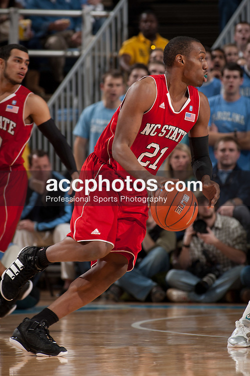 CHAPEL HILL, NC - JANUARY 29: C.J. Williams #21 of the North Carolina State Wolfpack dribbles the ball while playing the North Carolina Tar Heels on January 29, 2011 at the Dean E. Smith Center in Chapel Hill, North Carolina. North Carolina won 84-64. (Photo by Peyton Williams/UNC/Getty Images)  *** Local Caption *** C.J. Williams