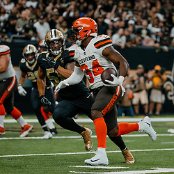 Sep 16, 2018; New Orleans, LA, USA; Cleveland Browns running back Carlos Hyde (34) runs past New Orleans Saints linebacker Manti Te'o (51) for a touchdown during the third quarter of a game at the Mercedes-Benz Superdome. The Saints defeated the Browns 21-18. Mandatory Credit: Derick E. Hingle-USA TODAY Sports