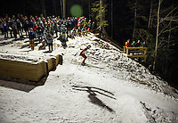 A skiers shadow on the snow as she takes off from the 28 meter jump during Plymouth High School's ski jumping meet on Friday evening. (Karen Bobotas/for the Laconia Daily Sun)