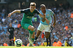 Tottenham Hotspur's Juan Foyth (left) and Manchester City's Raheem Sterling battle for the ball during the Premier League match at the Etihad Stadium, Manchester.