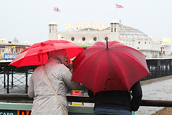 © Licensed to London News Pictures. 13/08/2015. Brighton, UK. The old victorian sewers that are now used as overflow for rain were unable to cope with the sudden torrential downpour in Brighton resulting in floods underneath the pier and the on the seafront. Today August  13th 2015. Photo credit : Hugo Michiels/LNP