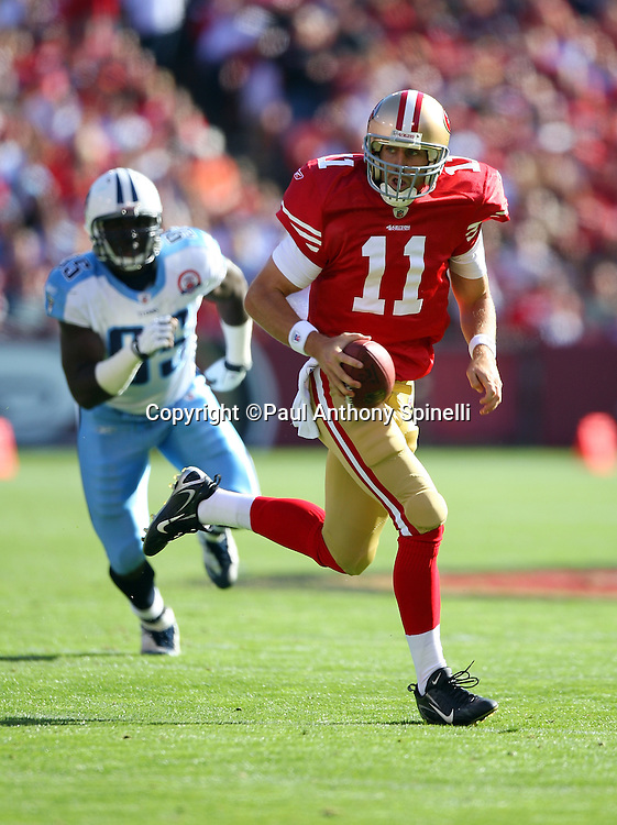San Francisco 49ers quarterback Alex Smith (11) rolls out and runs the ball during the NFL football game against the Tennessee Titans, November 8, 2009 in San Francisco, California. The Titans won the game 34-27. (©Paul Anthony Spinelli)