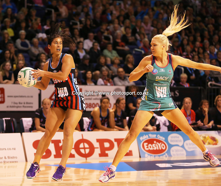 Keshia Grant of the Tactix with the ball and Kate Moloney of the Vixens in defence during the ANZ Championship Netball between Mainland Tactix v Melbourne Vixens, held at CBS Arena, Christchurch. 31 March 2014 Photo: Joseph Johnson/www.photosport.co.nz