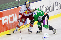 Douglas Lynch  of Salzburg  vs Tomi Mustonen of Olimpija during ice-hockey match between HDD Tilia Olimpija Ljubljana (SLO) and EC Red Bull Salzburg (AUT) in 2nd Quaterfinals of EBEL league, on March 1, 2011 in Hala Tivoli, Ljubljana, Slovenia. Red Bull Salzburg defeated Tilia Olimpija 5-1. (Photo By Vid Ponikvar / Sportida.com)