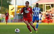 Luke Rooney on the ball during the Pre-Season Friendly match between Crawley Town and Brighton and Hove Albion at the Checkatrade.com Stadium, Crawley, England on 22 July 2015. Photo by Michael Hulf.