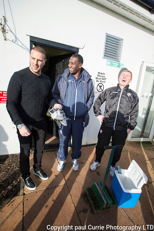 Pictures show TV star Paddy McGuinness with Emile Heskey after Paddy tweeted that he would clean his boots if he scored in his first game.<br />