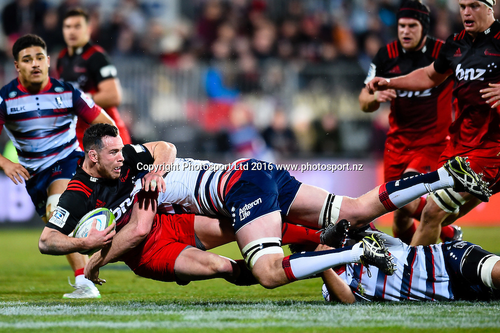 Ryan Crotty of the Crusaders is tackled by Sam Jeffries of the Rebels during the Super Rugby Match, Crusaders V Rebels, AMI Stadium, Christchurch, New Zealand. 9th July 2016. Copyright Photo: John Davidson / www.photosport.nz