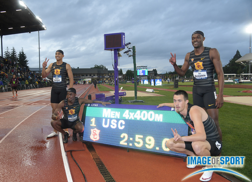 Jun 8, 2018; Eugene, OR, USA; Members of the Southern California Trojans 4 x 400m relay pose after winning in a collegiate record 2:59.00 during the NCAA Track and Field championships at Hayward Field.