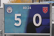 The score board shows the full time score 5-0 at the end of  the FA Women's Super League match between Manchester City Women and West Ham United Women at the Sport City Academy Stadium, Manchester, United Kingdom on 17 November 2019.