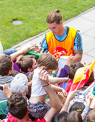 28.05.2012, Sportplatz Golm FC Schruns, Schruns, AUT, UEFA EURO 2012, Trainingslager, Spanien, im Bild  Sergio Ramos ESP Sergio Ramos of Spain) gibt Autogramme  of Spain during of Spanish National Footballteam for preparation UEFA EURO 2012 at Sportplatz Golm FC Schruns, Schruns, Austria on 2012/05/28. EXPA Pictures © 2012, PhotoCredit: EXPA/ Peter Rinderer