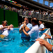 """Groups of Jehovah's Witnesses are baptized at the """"God's Word is Truth"""" convention at Qualcomm Stadium in San Diego."""