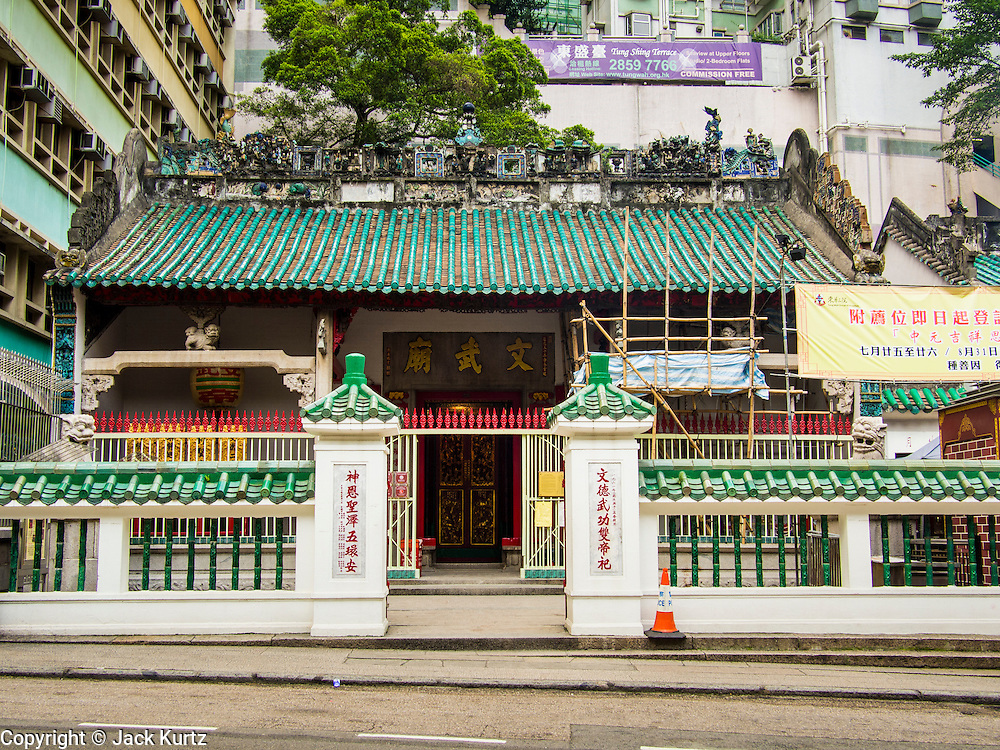 10 AUGUST 2013 - HONG KONG:    Man Mo Temple in Hong Kong. Hong Kong is one of the two Special Administrative Regions of the People's Republic of China, Macau is the other. It is situated on China's south coast and, enclosed by the Pearl River Delta and South China Sea, it is known for its skyline and deep natural harbour. Hong Kong is one of the most densely populated areas in the world, the  population is 93.6% ethnic Chinese and 6.4% from other groups. The Han Chinese majority originate mainly from the cities of Guangzhou and Taishan in the neighbouring Guangdong province.      PHOTO BY JACK KURTZ