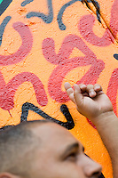 "2 August, 2008. New York, NY. Angel Ortiz, 41, a graffiti artist who collaborated with Keith Haring in the 80's, is here showing the tag he made on July 22nd 2008 on Keith Haring mural of Bowery and Houston street.  Angel Ortiz tagged his nickname ""LA2"", which refers to ""Little Angel"", on the Keith Haring mural that was reproduced on May 4th 2008, after the original 1982 graffiti was painted over. Angel Ortiz asked Clayton Patterson, an artist and gallerist, to help him tag the wall with his own artwork. Mr. Ortiz has accused the Haring Foundation of denying him credit on many of the jointly produced works.  The two artists met in 1980, when Angel Ortiz was 13 years old. Subsequently, Ortiz and Haring collaborated for several years and had joint shows. <br />  ©2008 Gianni Cipriano for The New York Times<br /> cell. +1 646 465 2168 (USA)<br /> cell. +1 328 567 7923 (Italy)<br /> gianni@giannicipriano.com<br /> www.giannicipriano.com"