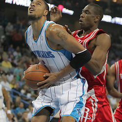 16 March 2009: New Orleans Hornets center Tyson Chandler (6) is defended by Houston Rockets center Dikembe Mutombo (55) during a NBA game between the New Orleans Hornets and the Houston Rockets at the New Orleans Arena in New Orleans, Louisiana.