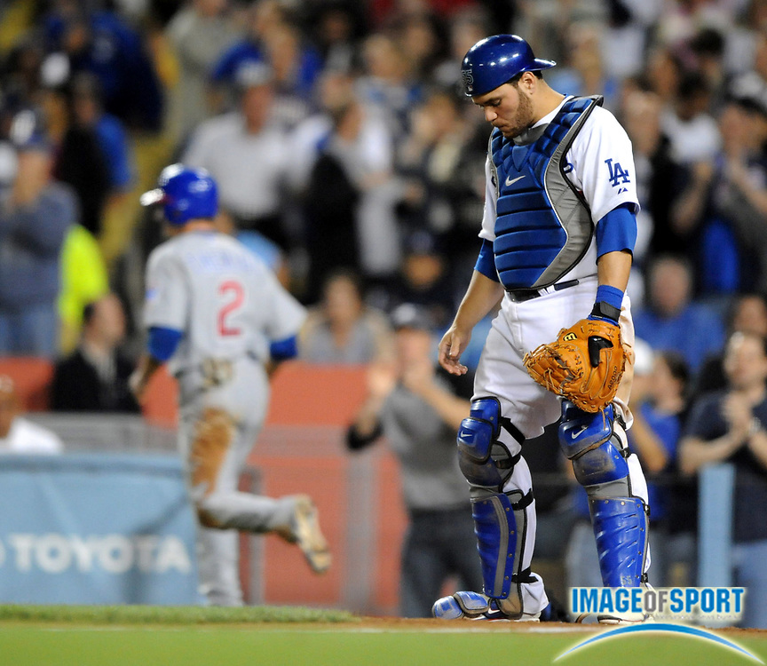 June 2, 2008; Los Angeles, CA, USA; Los Angeles Dodgers catcher Russell Martin (55), right, reacts after Chicago Cubs shorstop Ryan Theriot (2) scores in the ninth inning with the winning run in 5-4 victory at Dodger Stadium.