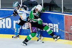 Franklin MacDonald (EHC Liwest Linz, #5) vs Petr Sachl (HDD Tilia Olimpija, #12) during of ice-hockey match between HDD Tilia Olimpija and EHC Liwest Linz in 15th Round of EBEL league, on October 25, 2011 at Hala Tivoli, Ljubljana, Slovenia. (Photo By Matic Klansek Velej / Sportida)