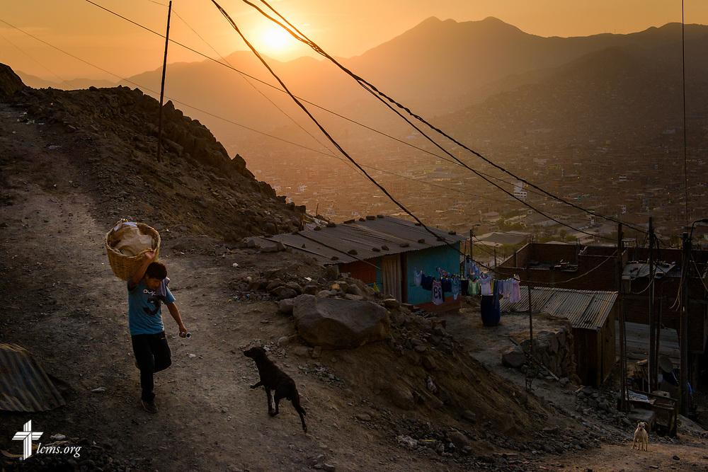 The sun sets over San Juan de Lurigancho on Tuesday Nov. 7 2017, in Peru.  LCMS Communications/Erik M. Lunsford