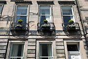 Housing architecture plus ironwork balconies and street lighting  on Gloucester Terrace in Edinburgh, on 26th June 2019, in Edinburgh, Scotland.