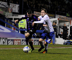 Bristol Rovers' Michael Smith jostles for the ball with Bury's Danny Mayor - Photo mandatory by-line: Dougie Allward/JMP - Mobile: 07966 386802 01/04/2014 - SPORT - FOOTBALL - Bury - Gigg Lane - Bury v Bristol Rovers - Sky Bet League Two